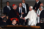 Pope Francis talks with Cardinal Timothy Dolan as he leaves St Patrick's Cathedral September 24 2015 in New York City The pope is on a sixday visit...