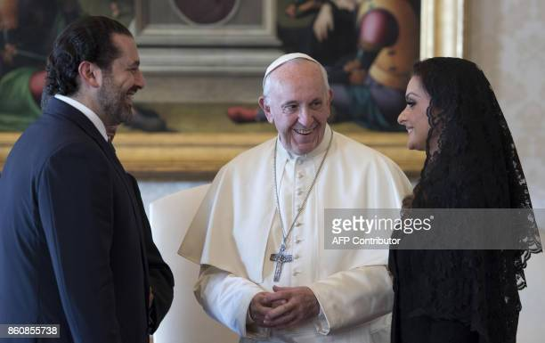 Pope Francis talks with Prime Minister of Lebanon Saad Hariri and his wife Lara during a private audience at the Vatican on October 13 2017 / AFP...