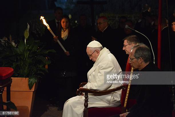 Pope Francis the Via Crucis torchlight procession on Good Friday in front of the Colosseum in Rome Italy on March 25 2016 Good Friday is a Christian...