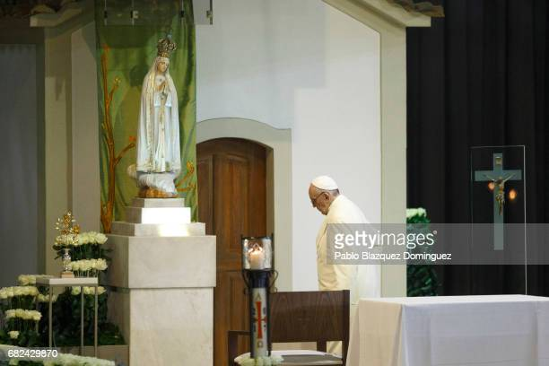Pope Francis walks in front of a figure representing Our Lady of The Apparitions during the Blessing for the Candles at the Chapple of Apparitions in...