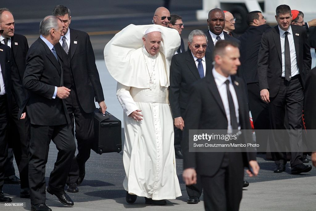 Pope Francis (C) walks on the tarmac next to Cuba's president <a gi-track='captionPersonalityLinkClicked' href=/galleries/search?phrase=Raul+Castro&family=editorial&specificpeople=239452 ng-click='$event.stopPropagation()'>Raul Castro</a> (R) upon his arrival in Cuba, on February 12, 2016, in Havana, Cuba. Pope Francis met with Russian Orthodox Patriarch Kirill at Havana's Jose Marti airport, marking the first meeting between the heads of the two churches some 1,000 years since the breakup of the two Christian churches.