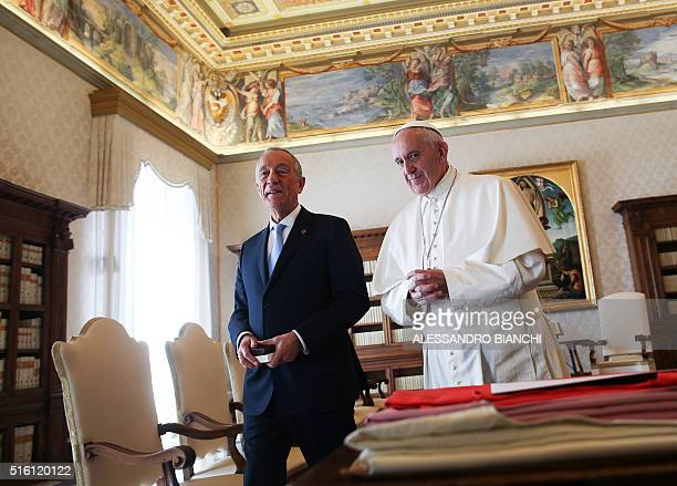 Pope Francis walks with Portuguese President Marcelo Rebelo de Sousa during a private audience at the Vatican on March 17 2016 AFP PHOTO POOL /...