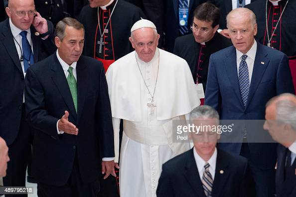Pope Francis walks with Speaker of the House John Boehner and US Vice President Joe Biden after deliver an address to a joint session of Congress in...