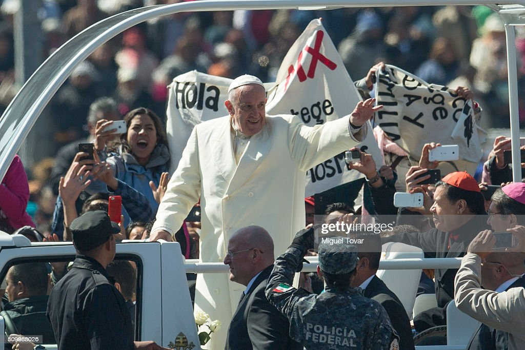 Pope Francis waves as he arrives at Zocalo main square on February 13, 2016 in Mexico City, Mexico. Pope Francis will be on a five days visit in Mexico from February 12 to 17 where he is expected to visit five states.