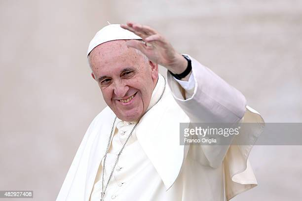 Pope Francis waves as he arrives in St Peter's Square for an audience with thousands of altar servers from around Europe on August 4 2015 in Vatican...