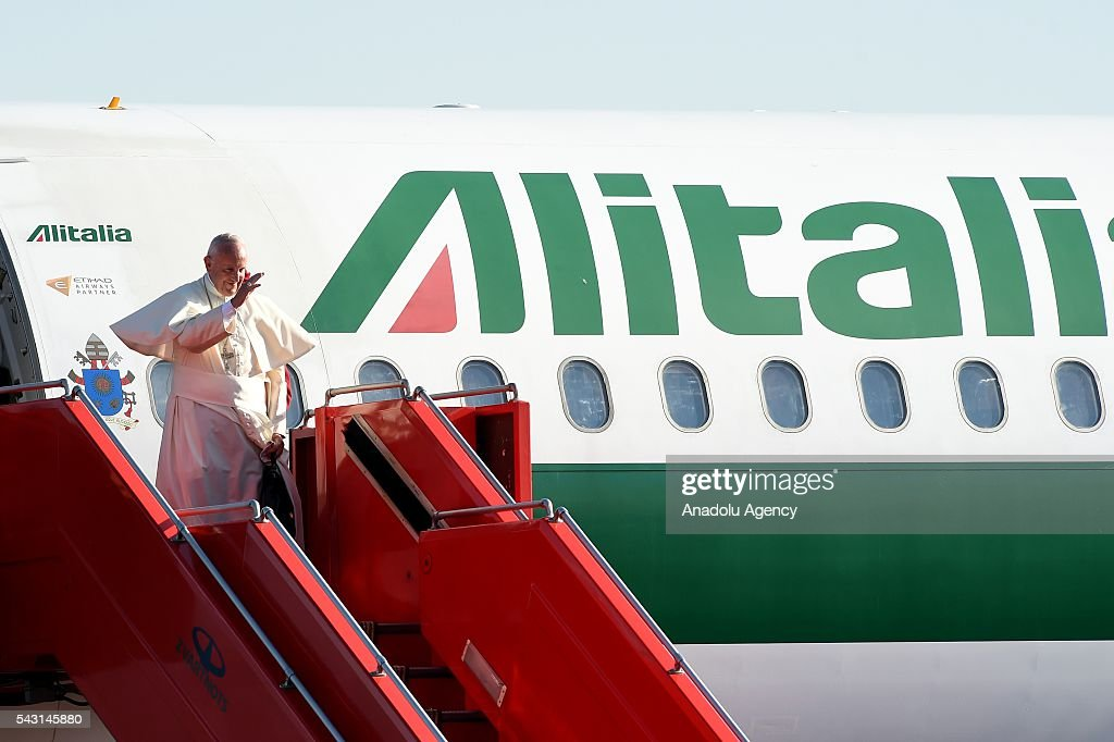 Pope Francis waves as he boards a plane for Rome at Yerevan's Zvartnots Airport in Yerevan, Armenia on June 26, 2016.