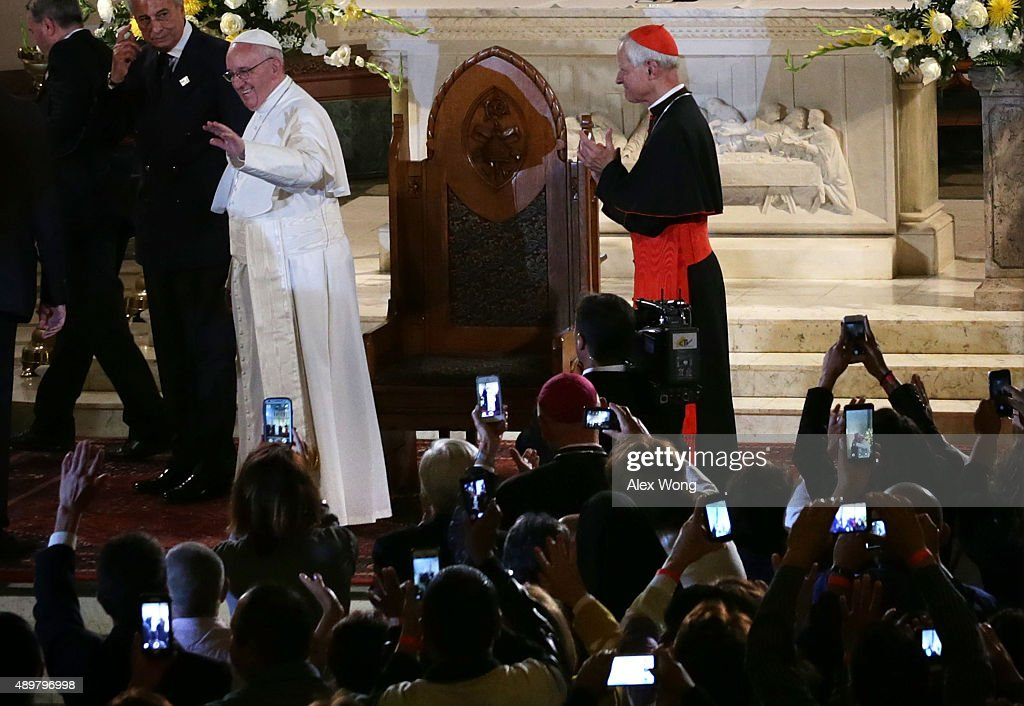 <a gi-track='captionPersonalityLinkClicked' href=/galleries/search?phrase=Pope+Francis&family=editorial&specificpeople=2499404 ng-click='$event.stopPropagation()'>Pope Francis</a> waves as he leaves after his visit at St. Patrick's Catholic Church as Cardinal Donald Wuerl (R) of Archbishop of Washington looks on September 24, 2015 in Washington, DC. The Pope is on a six-day trip to the U.S., with stops in Washington, New York City and Philadelphia.