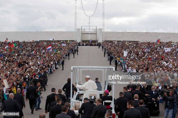 Pope Francis waves as he leaves the Sanctuary of Fatima on May 12 2017 in Fatima Portugal Pope Francis will be attending the Sanctuary of Fatima in...