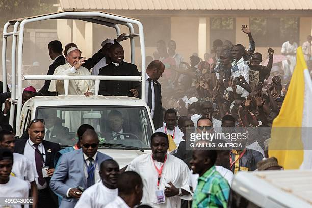Pope Francis waves as he visits the Koudoukou school to meet people from the muslim community after leaving the Central Mosque in the PK5...