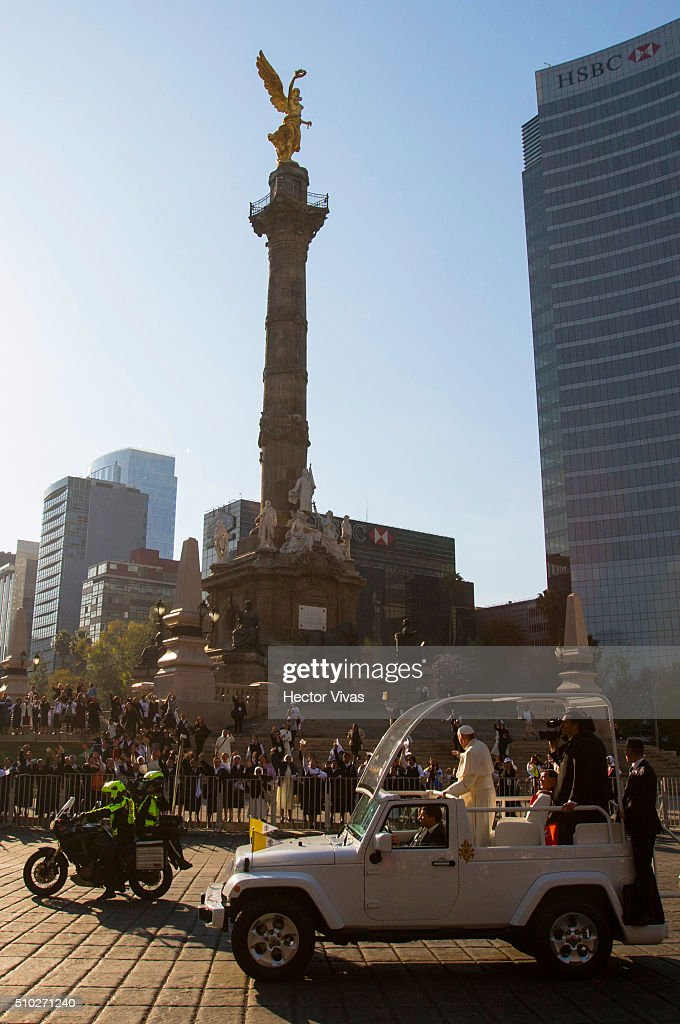 Pope Francis waves at Angel de la Independencia statue on February 14, 2016 in Mexico City, Mexico. Pope Francis will be on a five-day visit in Mexico from February 12 to 17 where he is expected to visit five states.