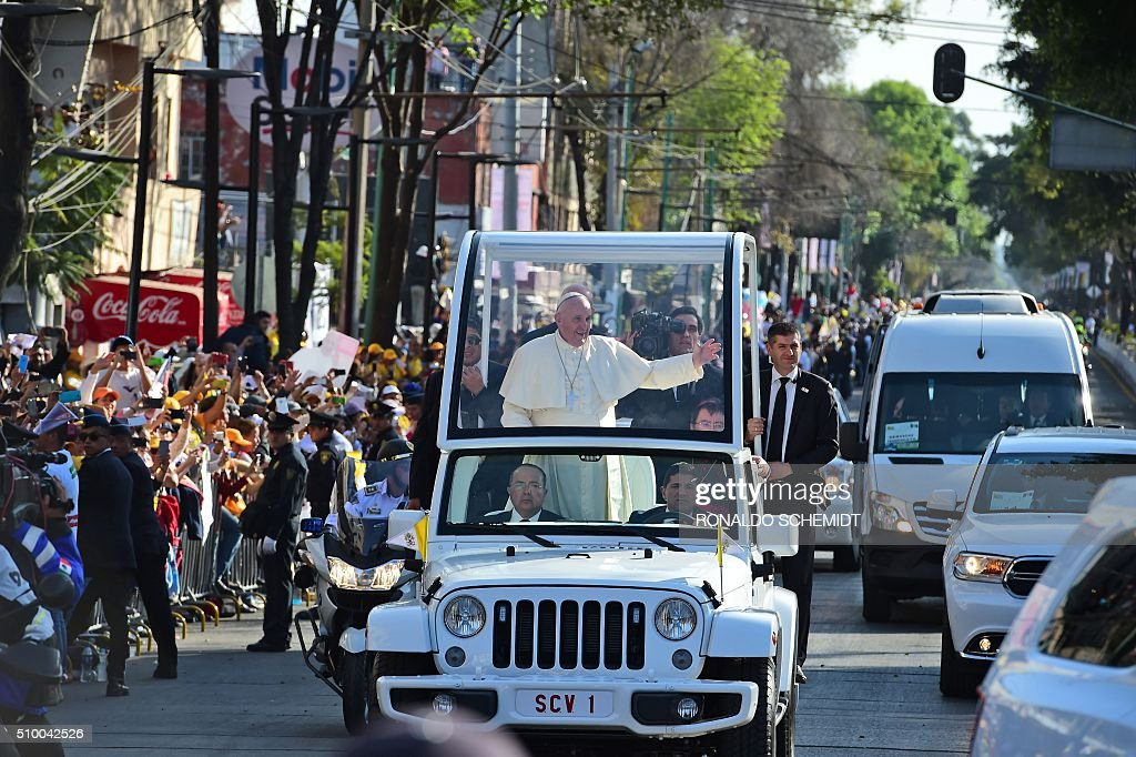 Pope Francis waves at the crowd from the popemobile on his way to the Guadalupe Basilica in Mexico City on February 13, 2016. Pope Francis urged Mexican bishops Saturday to take on drug trafficking with 'prophetic courage,' warning that it represents a moral challenge to society and the church. AFP PHOTO / RONALDO SCHEMIDT / AFP / RONALDO SCHEMIDT