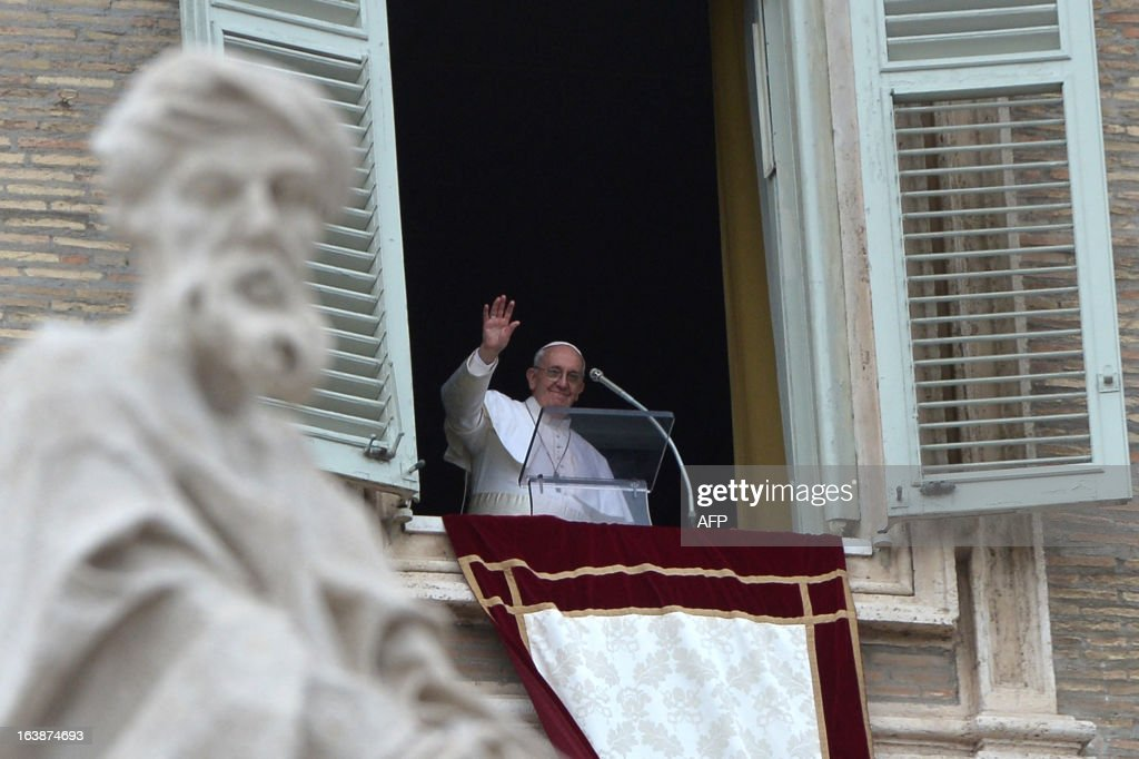 Pope Francis waves at the end of the Angelus prayer at St Peter's square on March 17, 2013 at the Vatican. Pope Francis begins his papacy in earnest today ahead of his formal inauguration mass, with a weekly prayer address used by previous pontiffs to comment on international affairs. The pope's first Angelus prayer, delivered from a window high above St Peter's Square, is a chance for the first Latin American pontiff to begin to sketch out a more global vision for the role of the Roman Catholic Church.