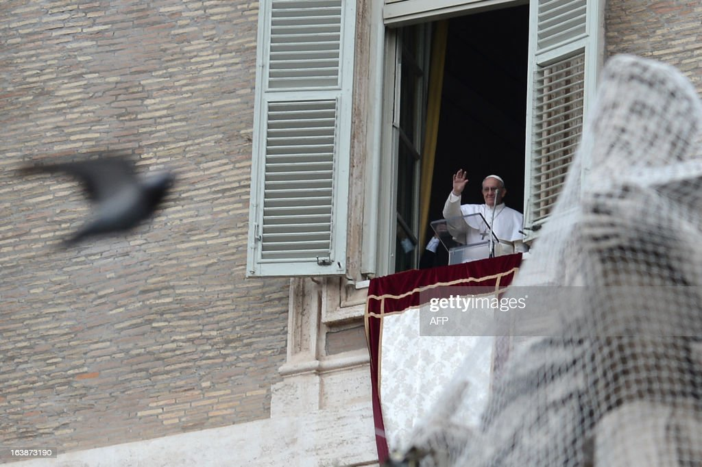 Pope Francis waves at the window as he leads the Angelus prayer at St Peter's square on March 17, 2013 at the Vatican. Pope Francis begins his papacy in earnest today ahead of his formal inauguration mass, with a weekly prayer address used by previous pontiffs to comment on international affairs. The pope's first Angelus prayer, delivered from a window high above St Peter's Square, is a chance for the first Latin American pontiff to begin to sketch out a more global vision for the role of the Roman Catholic Church.