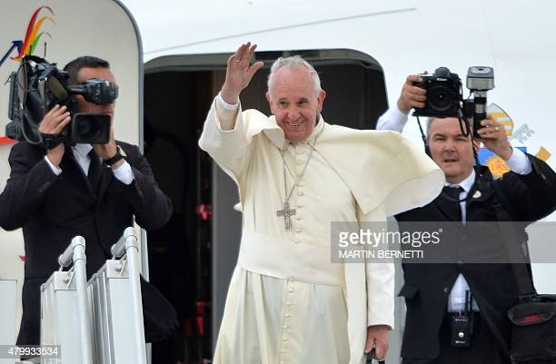 Pope Francis waves before boarding a plane bound for Bolivia at Quito's airport on July 8 2015 Pope Francis the first Latin American pontiff heads...
