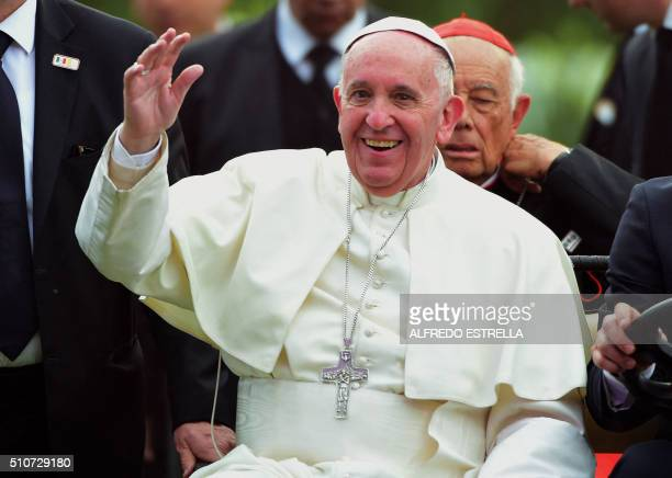 Pope Francis waves during a meeting with young people at Morelos stadium in Morelia Michoacan State Mexico on February 16 2016 Pope Francis urged...