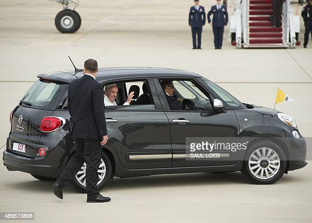 Pope Francis waves from his car a Fiat upon arrival at Andrews Air Force Base in Maryland September 22 on the start of a 3day trip to Washington AFP...