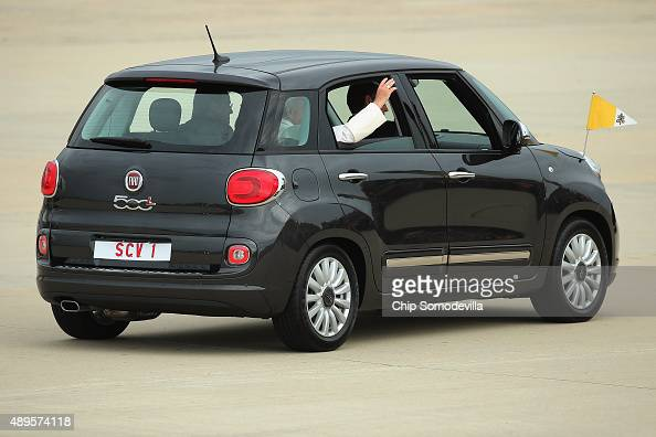 Pope Francis waves from the back of his Fiat after arriving from Cuba September 22 2015 at Joint Base Andrews Maryland Francis will be visiting...