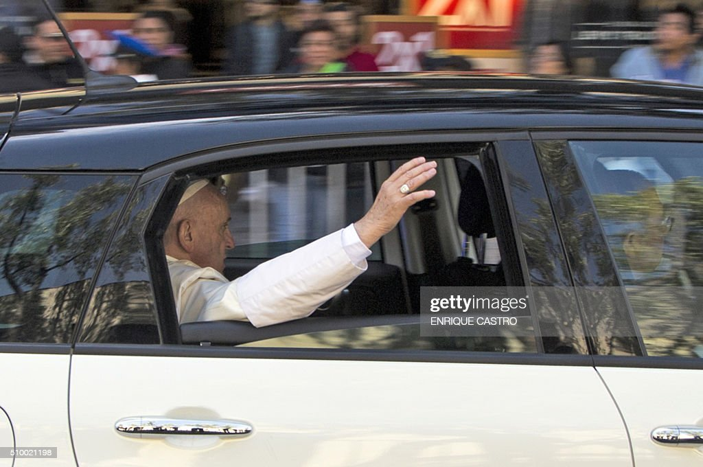 Pope Francis waves from the his car on his way to the Nuncianture, in Mexico City on February 13, 2016. Francis became the first pope to enter Mexico's National Palace to meet President Enrique Pena Nieto, as he starts a cross-country tour that will highlight the country's violence and migration troubles. AFP PHOTO/ENRIQUE CASTRO / AFP / ENRIQUE CASTRO