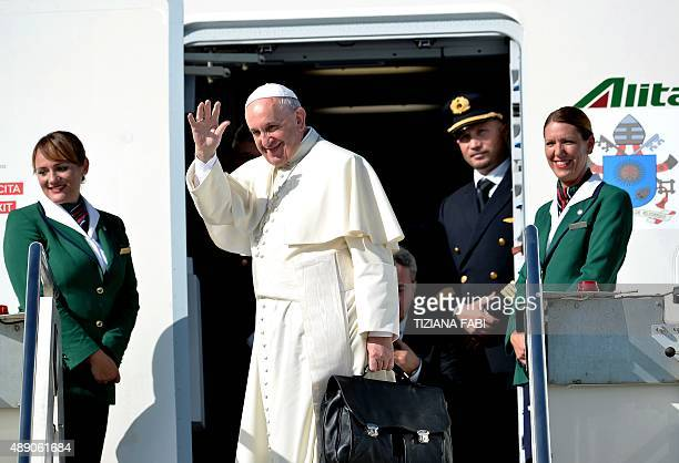Pope Francis waves from the plane's steps upon his arrival at the Rome's Fiumicino airport on September 19 2015 The pontiff heads for Cuba on...