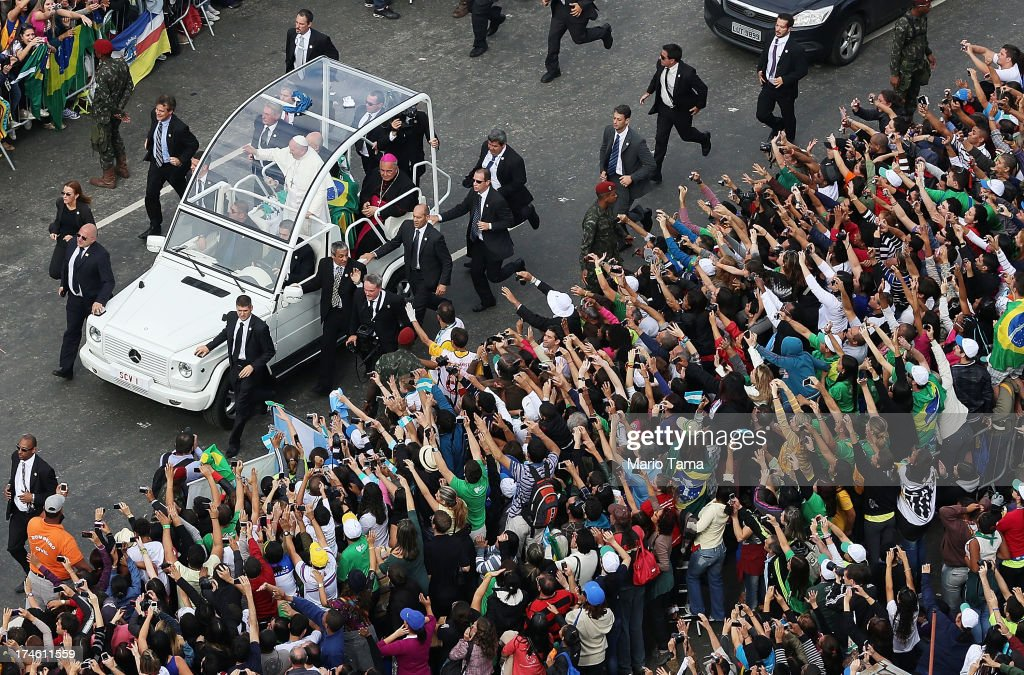 Pope Francis waves from the Popemobile as he arrives to celebrate Mass on Copacabana Beach during World Youth Day celebrations on July 28, 2013 in Rio de Janeiro, Brazil. More than 1.5 million pilgrims are expected to join the pontiff for his visit to the Catholic Church's World Youth Day celebrations which is running July 23-28.