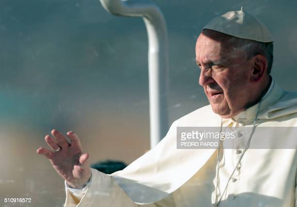 Pope Francis waves from the popemobile in Ciudad Juarez Chihuahua state Mexico on February 17 2016 Throngs gathered at Mexico's border with the...