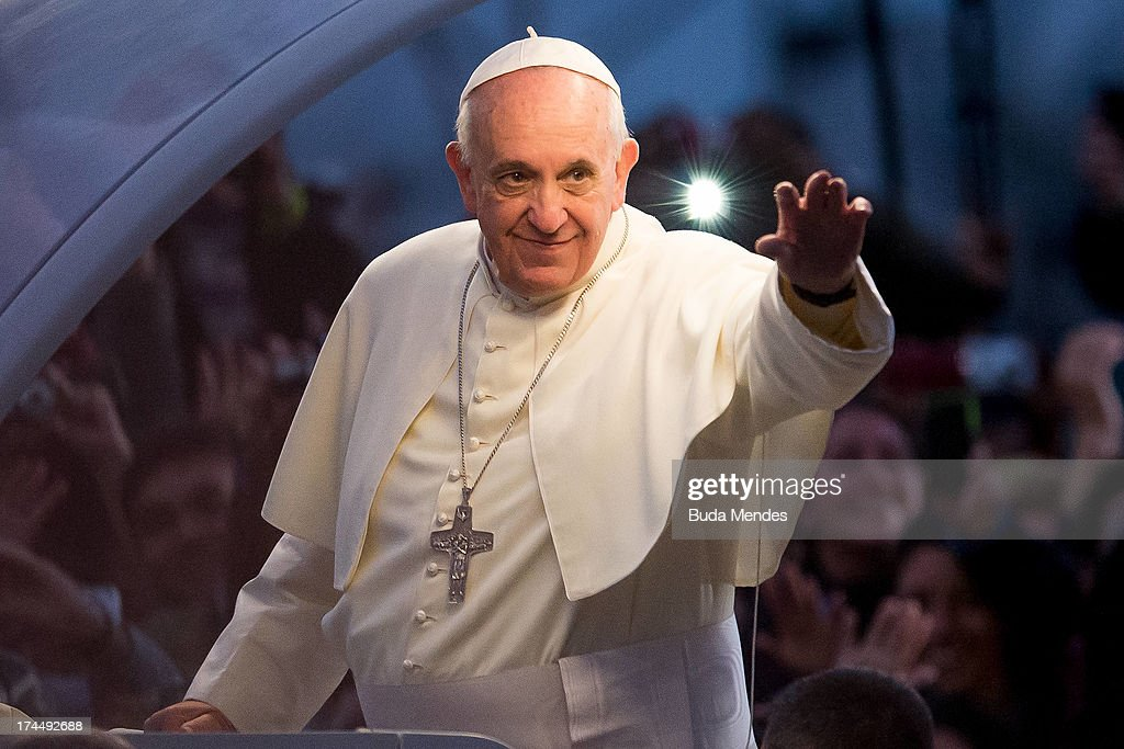 Pope Francis waves from the Popemobile on his way to attend the Via Crucis on Copacabana Beach during World Youth Day celebrations on July 26, 2013 in Rio de Janeiro, Brazil. More than 1.5 million pilgrims are expected to join the pontiff for his visit to the Catholic Church's World Youth Day celebrations which is running July 23-28.
