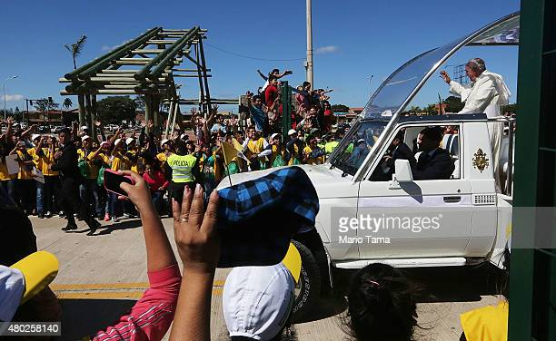 Pope Francis waves from the Popemobile on his way to the airport on July 10 2015 in Santa Cruz Bolivia The Pope visited one of Bolivia's most...