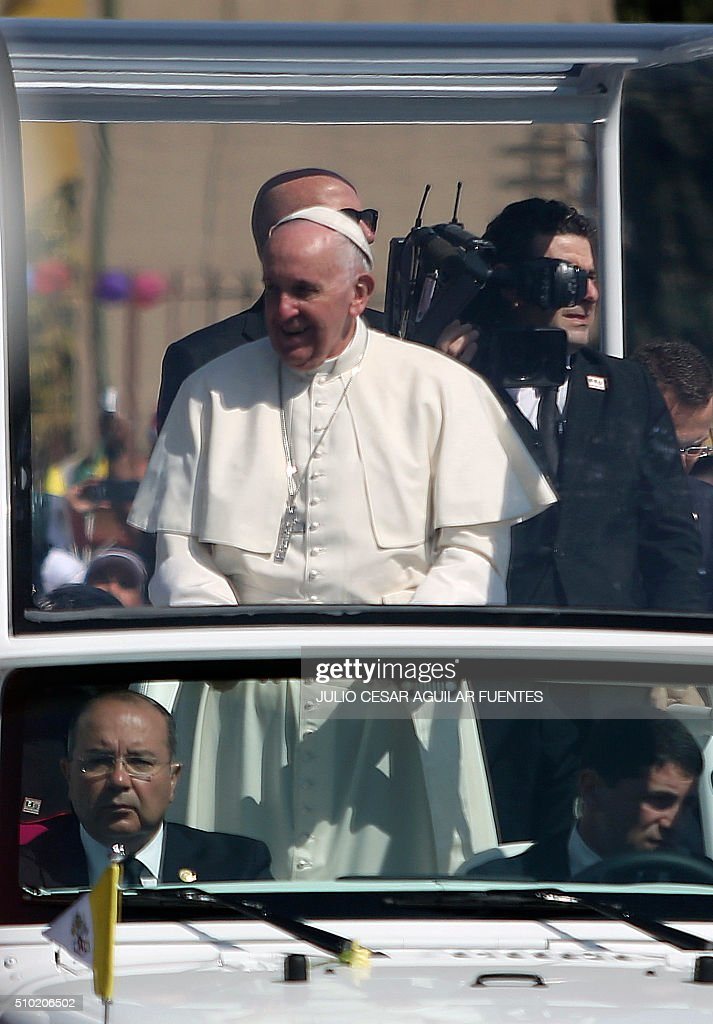 Pope Francis waves from the popemobile upon arrival in Ecatepec --a rough, crime-plagued Mexico City suburb-- where he is to celebrate an open-air mass, on February 14, 2016. The pope has chosen to visit some of Mexico's most troubled regions during his five-day trip to the world's second most populous Catholic country. AFP PHOTO/ JULIO CESAR AGUILAR / AFP / Julio Cesar Aguilar Fuentes