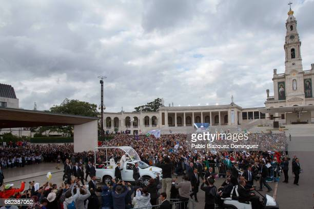 Pope Francis waves his hand as he leaves the Sanctuary of Fatima on May 12 2017 in Fatima Portugal Pope Francis will be attending the Sanctuary of...