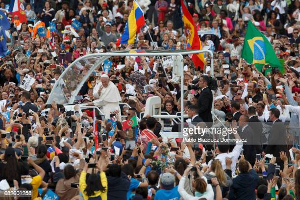 Pope Francis waves his hand as he leaves the Sanctuary of Fatima on May 13 2017 in Fatima Portugal Pope Francis is attending the Sanctuary of Fatima...
