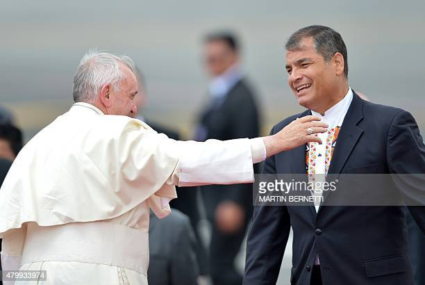 Pope Francis waves next to Ecuadorean President Rafael Correa before boarding a plane bound for Bolivia at Quito's airport on July 8 2015 Pope...
