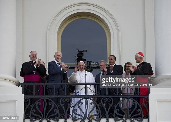 Pope Francis waves next to US Vice President Joe Biden and US Speaker of the House John Boehner at the Capitol building in Washington DC after...