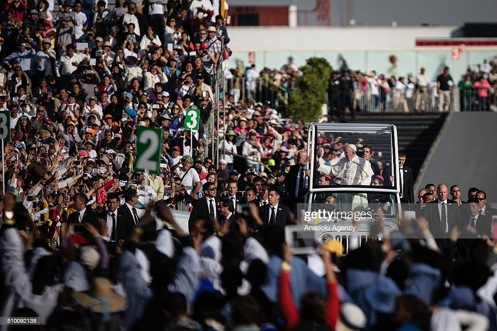 Pope Francis waves the crowd from the popemobile on his way to celebrates a mass at the Basilica de Guadalupe in Mexico City during his Pastoral Visit to Mexico on February 13, 2016.