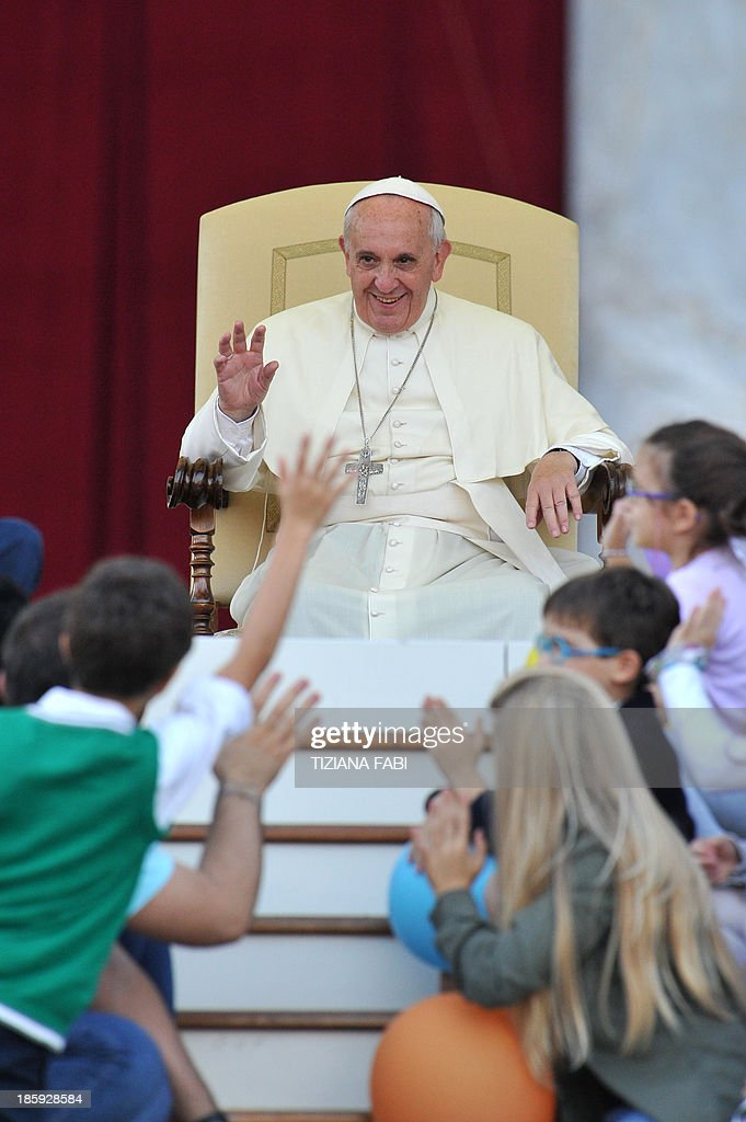 Pope Francis waves to children on the occasion of Family Day at St Peter's square on October 26, 2013 at the Vatican. AFP PHOTO / TIZIANA FABI