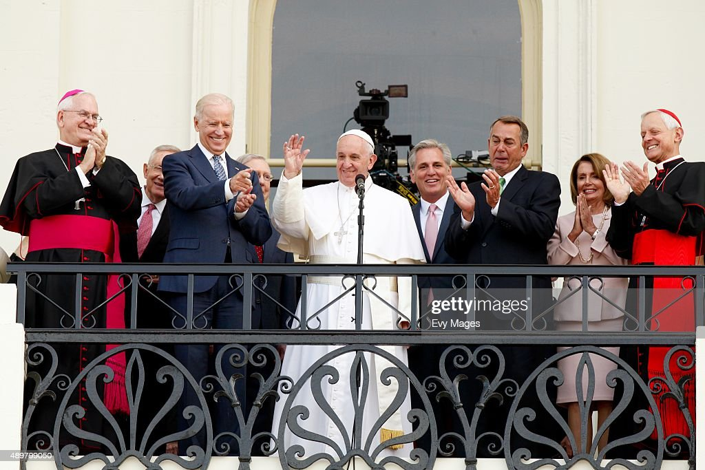 <a gi-track='captionPersonalityLinkClicked' href=/galleries/search?phrase=Pope+Francis&family=editorial&specificpeople=2499404 ng-click='$event.stopPropagation()'>Pope Francis</a> waves to crowd from the balcony of the US Capitol building, after his address to a joint meeting of the U.S. Congress as (L to R) Arch Bishop Joseph E. Kurtz, Senate Minority Leader Harry Reid (D-NV), Vice President Joe Biden, House Majority Leader <a gi-track='captionPersonalityLinkClicked' href=/galleries/search?phrase=Kevin+McCarthy+-+U.S.+Congressman&family=editorial&specificpeople=6726000 ng-click='$event.stopPropagation()'>Kevin McCarthy</a> (R-CA), Speaker of the House John Boehner (R-OH), House Democratic Leader Rep. Nancy Pelosi (D-CA) and Cardinal Donald Wuerl look on September 24, 2015 in Washington, D.C. <a gi-track='captionPersonalityLinkClicked' href=/galleries/search?phrase=Pope+Francis&family=editorial&specificpeople=2499404 ng-click='$event.stopPropagation()'>Pope Francis</a>, the first pope to address a joint meeting of Congress, will finish his tour of Washington later today before traveling to New York City.