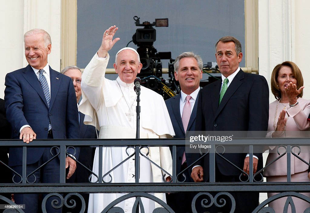 Pope Francis waves to crowd from the balcony of the US Capitol building after his address to a joint meeting of the US Congress as US Vice President...