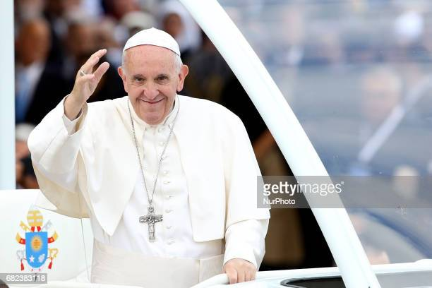 Pope Francis waves to devotees inside the popemobile at the Fatima Sanctuary in Leiria Portugal 12 May 2017 Pope Francis will preside over the...