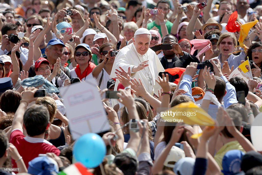 <a gi-track='captionPersonalityLinkClicked' href=/galleries/search?phrase=Pope+Francis&family=editorial&specificpeople=2499404 ng-click='$event.stopPropagation()'>Pope Francis</a> waves to faithful as he arrives in St. Peter's Square for his Weekly Audience on May 1, 2013 in Vatican City, Vatican. Marking the feast of St Joseph the Worker and World Labor Day today, the Pontiff launched an urgent appeal to Christians and men and women of goodwill worldwide to take decisive steps to end slave labor.