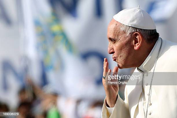 Pope Francis blows a kiss to the faithful as he arrives in St Peter's Square for the celebration of Pentecost Vigil with lay Ecclesial movements on...