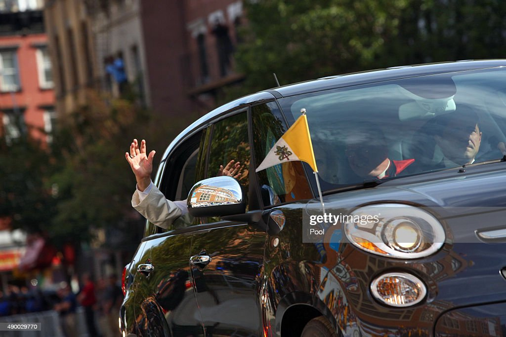 Pope Francis waves to guests upon his arrival at Our Lady Queen of Angels School on September 25, 2015 in the East Harlem neighborhood of New York City. Pope Francis is on a six-day trip to the USA, which includes stops in Washington DC, New York and Philadelphia, after a three-day stay in Cuba.