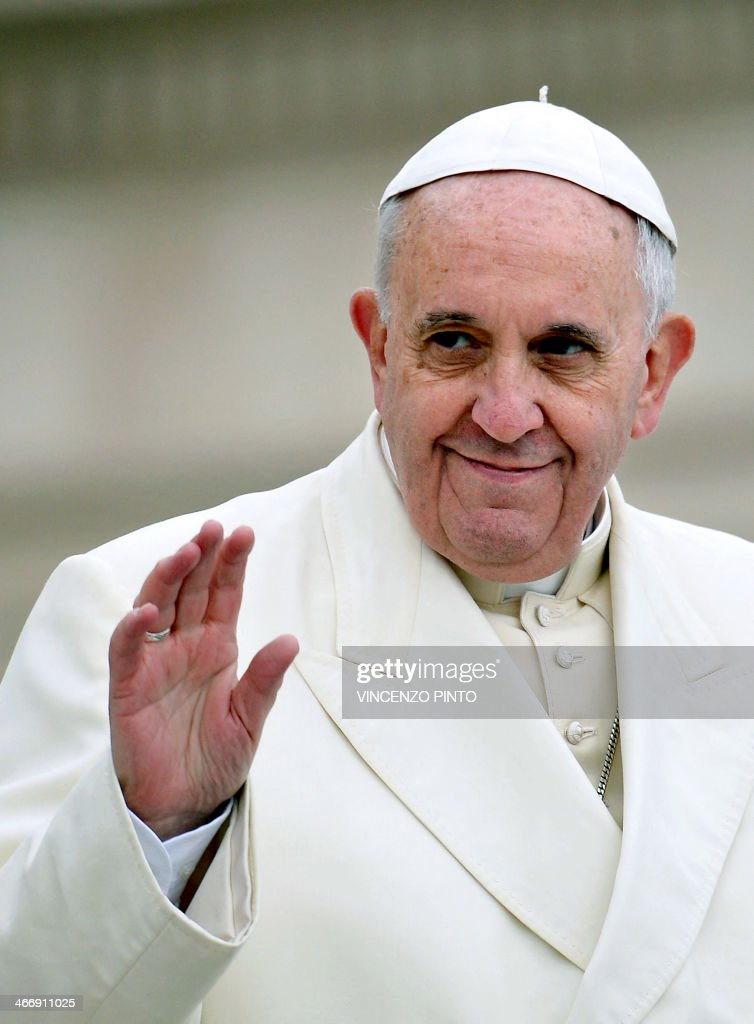 Pope Francis waves to pilgrims gathered at Saint Peter's square in the Vatican, at the end of the general weekly audience on February 5, 2014.
