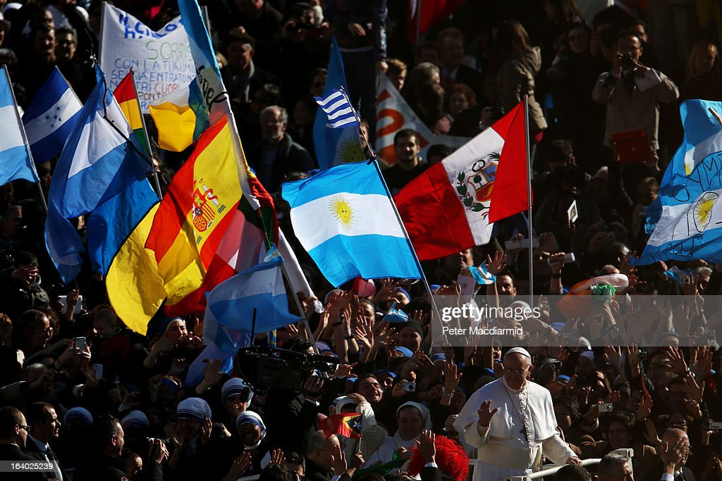 <a gi-track='captionPersonalityLinkClicked' href=/galleries/search?phrase=Pope+Francis&family=editorial&specificpeople=2499404 ng-click='$event.stopPropagation()'>Pope Francis</a> waves to the crowd as he arrives in the Pope Mobile for his Inauguration Mass in St Peter's Square on March 19, 2013 in Vatican City, Vatican. The mass is being held in front of an expected crowd of up to one million pilgrims and faithful who have filled the square and the surrounding streets to see the former Cardinal of Buenos Aires officially take up his role as pontiff. <a gi-track='captionPersonalityLinkClicked' href=/galleries/search?phrase=Pope+Francis&family=editorial&specificpeople=2499404 ng-click='$event.stopPropagation()'>Pope Francis</a>' inauguration takes place in front of Cardinals and spiritual leaders as well as heads of state from around the world.