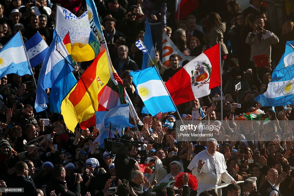 Pope Francis waves to the crowd as he arrives in the Pope Mobile for his Inauguration Mass in St Peter's Square on March 19, 2013 in Vatican City, Vatican. The mass is being held in front of an expected crowd of up to one million pilgrims and faithful who have filled the square and the surrounding streets to see the former Cardinal of Buenos Aires officially take up his role as pontiff. Pope Francis' inauguration takes place in front of Cardinals and spiritual leaders as well as heads of state from around the world.