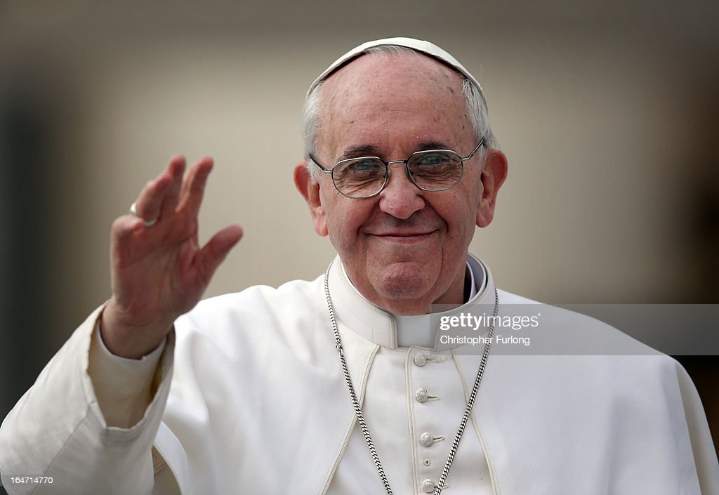 Pope Francis waves to the crowd as he drives around St Peter's Square ahead of his first weekly general audience as pope on March 27, 2013 in Vatican City, Vatican. Pope Francis held his weekly general audience in St Peter's Square today