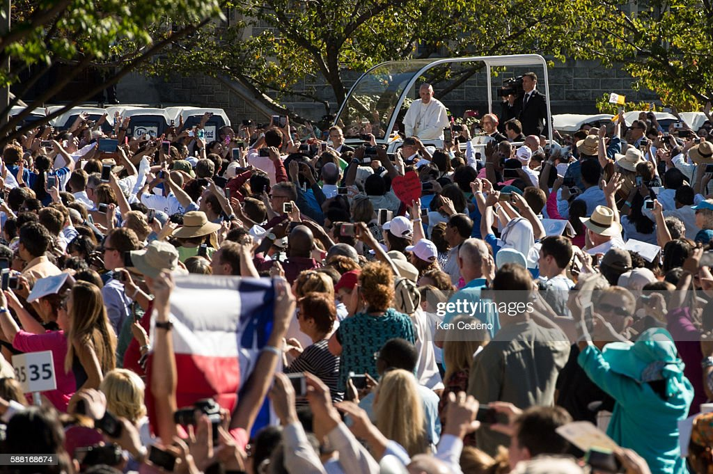 Pope Francis waves to the crowd before conducting mass and the Canonization of Blessed Junipero Serra at the Basilica of the National Shrine of the...