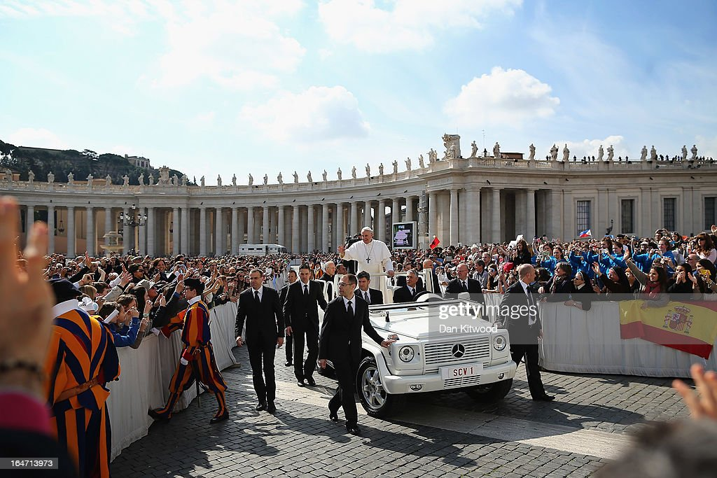 Pope Francis waves to the crowd from an open-air jeep, ahead of his weekly general audience, in St Peter's Square on March 27, 2013 in Vatican City, Vatican. Pope Francis held his weekly general audience in St Peter's Square today.