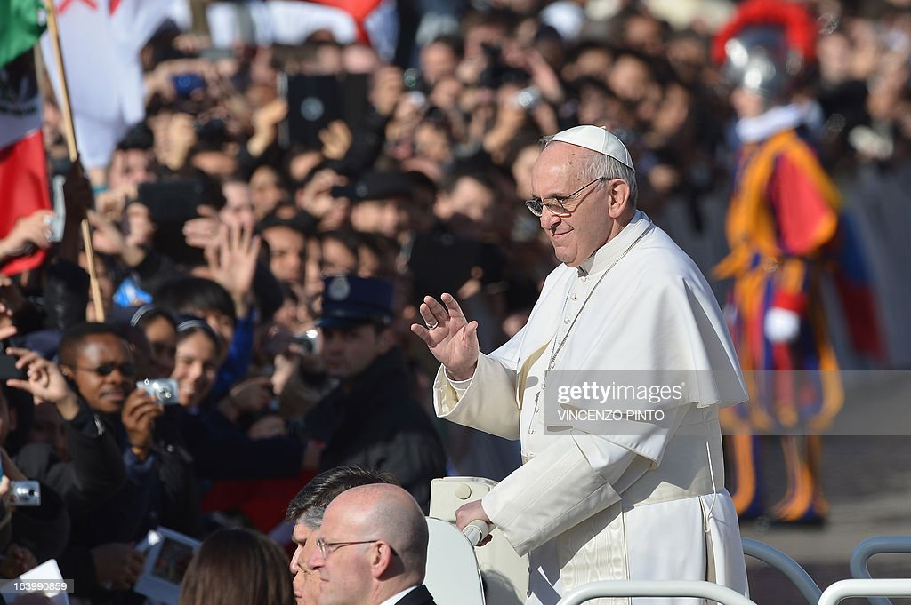 Pope Francis waves to the crowd from the papamobile during his inauguration mass at St Peter's square on March 19, 2013 at the Vatican. World leaders flew in for Pope Francis's inauguration mass in St Peter's Square on Tuesday where Latin America's first pontiff will receive the formal symbols of papal power.