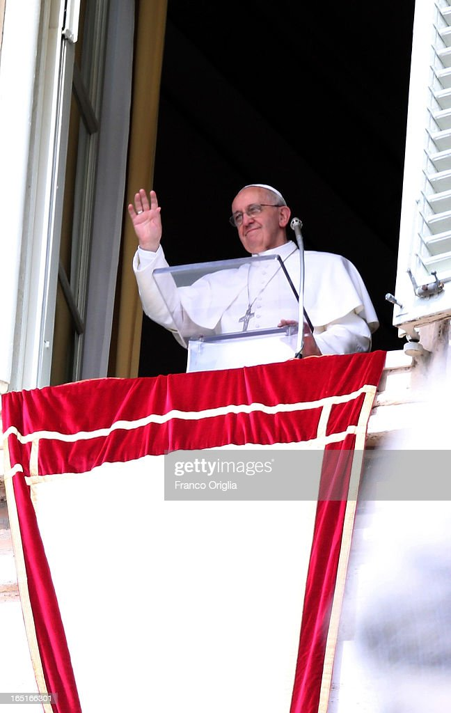 <a gi-track='captionPersonalityLinkClicked' href=/galleries/search?phrase=Pope+Francis&family=editorial&specificpeople=2499404 ng-click='$event.stopPropagation()'>Pope Francis</a> waves to the crowd from the window of his studio overlooking St. Peter's Square during the Regina Coeli Prayer on April 1, 2013 in Vatican City, Vatican.