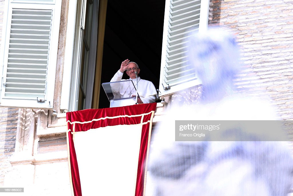 Pope Francis waves to the crowd from the window of his studio overlooking St. Peter's Square during the Regina Coeli Prayer on April 1, 2013 in Vatican City, Vatican.