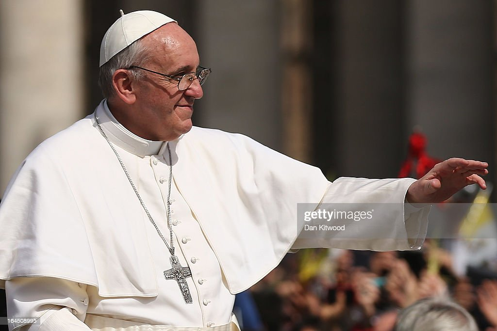 <a gi-track='captionPersonalityLinkClicked' href=/galleries/search?phrase=Pope+Francis&family=editorial&specificpeople=2499404 ng-click='$event.stopPropagation()'>Pope Francis</a> waves to the crowds during a drive around St. Peter's Square after delivering his blessing to the palms and to the faithful gathered in St. Peter's Square during Palm Sunday Mass on March 24, 2013 in Vatican City, Vatican. <a gi-track='captionPersonalityLinkClicked' href=/galleries/search?phrase=Pope+Francis&family=editorial&specificpeople=2499404 ng-click='$event.stopPropagation()'>Pope Francis</a> lead his first mass of Holy Week as pontiff by celebrating Palm Sunday in front of thousands of faithful and clergy. The pope's first holy week will also incorporate him washing the feet of prisoners in a youth detention centre in Rome next Thursday, March 28.